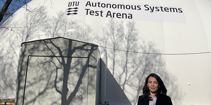 Lorena Ximena in front of the new Autonomous Systems Test Arena (ASTA).